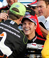 Despite winning the Daytona 500, Trevor Bayne (right) isn't the points leader. Carl Edwards, who is congratulating him on his win, is.
